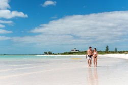 Abaco-Club-Couple-Walking-Beach-Horiz